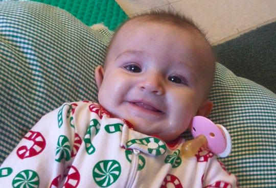 smiling baby at a Preschool & Daycare Serving Fort Erie, CO, Kansas City, KS