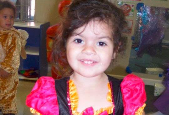 smiling girl at a Preschool & Daycare Serving Fort Erie, CO, Kansas City, KS