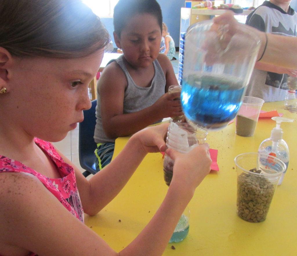 kids doing science at a Preschool & Daycare Serving Fort Erie, CO, Kansas City, KS
