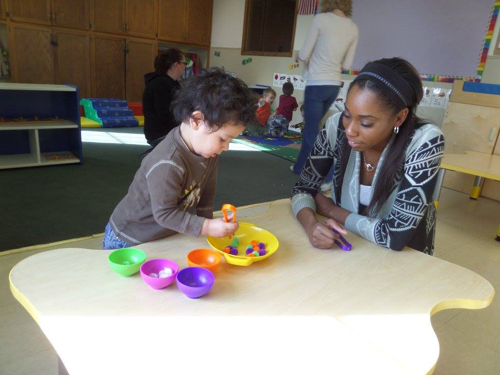 teacher and kid playing at a Preschool & Daycare Serving Fort Erie, CO, Kansas City, KS