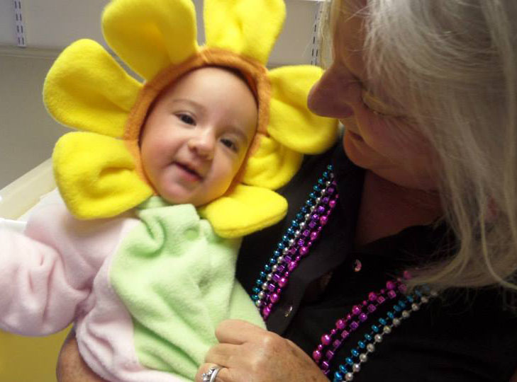 teacher with baby at a Preschool & Daycare Serving Fort Erie, CO, Kansas City, KS