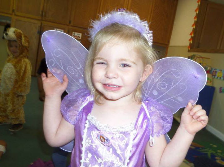 young girl smiling in butterfly costume at a Preschool & Daycare Serving Fort Erie, CO, Kansas City, KS