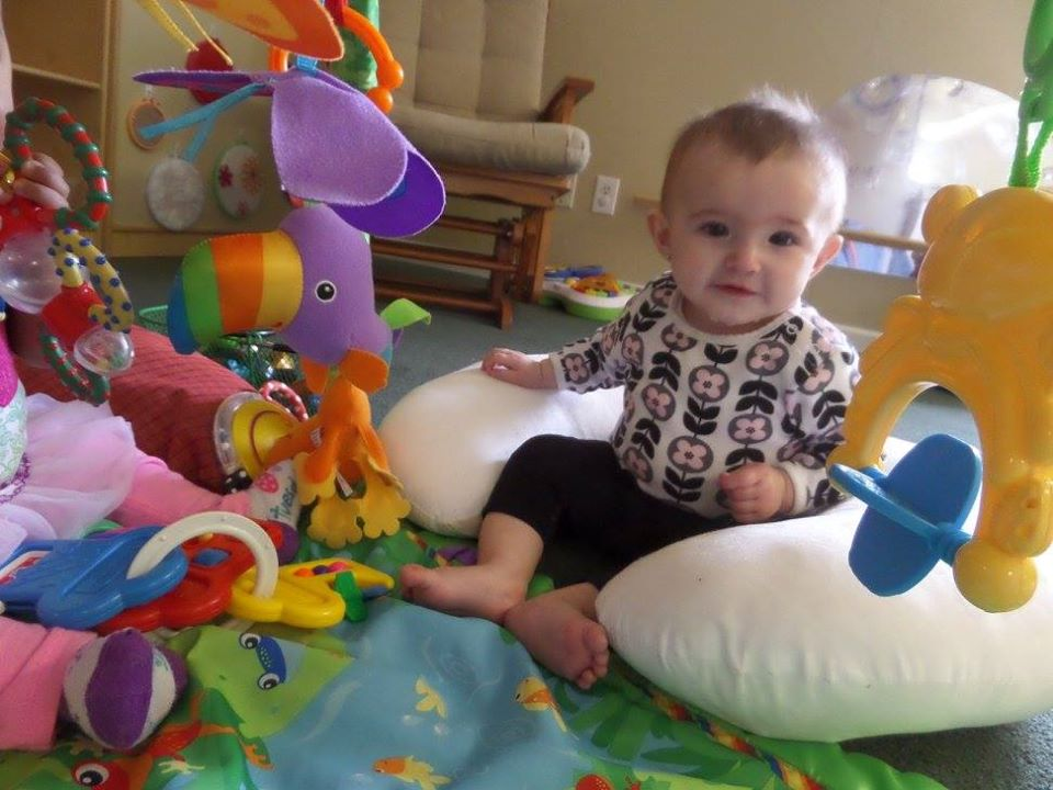 happy baby smiling at a Preschool & Daycare Serving Fort Erie, CO, Kansas City, KS