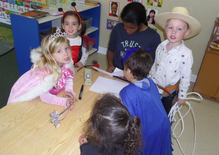 teacher with preschool children in class at a Preschool & Daycare Serving Fort Erie, CO, Kansas City, KS