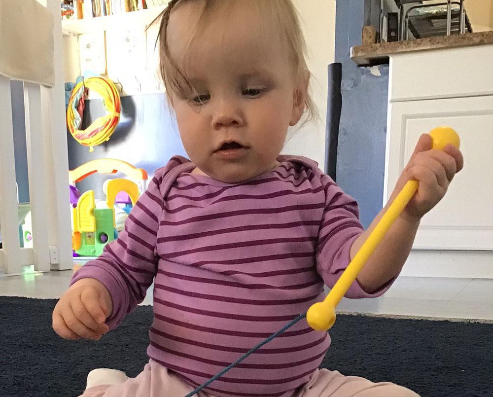 Cute toddler playing inside the classroom at a preschool & childcare center Serving Erie, CO & Kansas City, KS