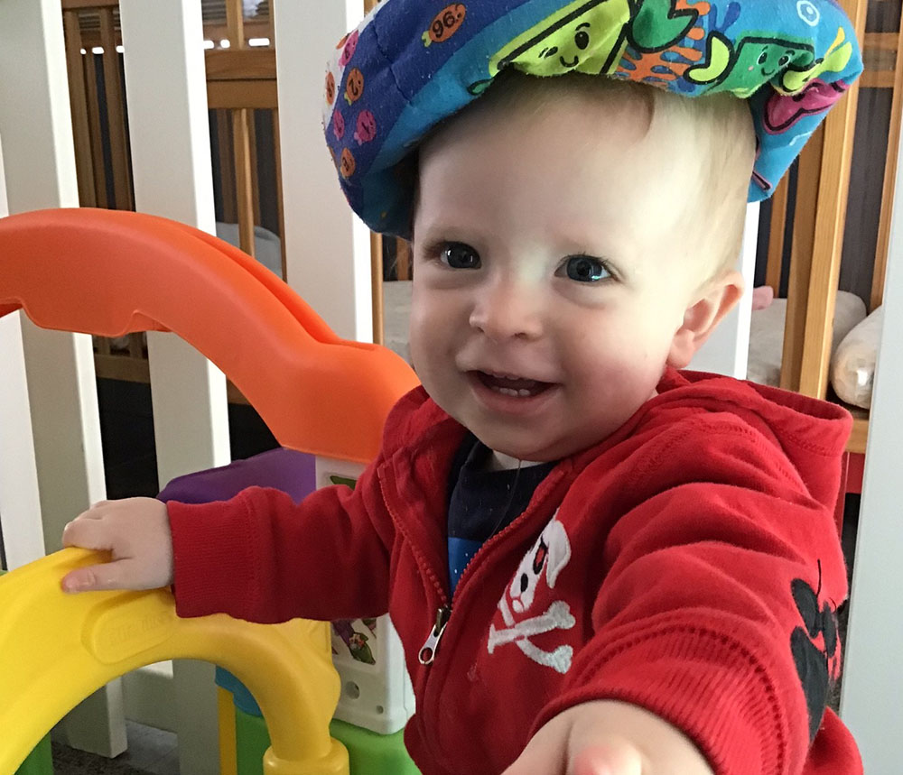 Smiling toddler and playing at a preschool & childcare center Serving Erie, CO & Kansas City, KS