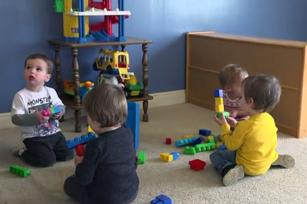 Toddlers playing colorful toys at a preschool & childcare center Serving Erie, CO & Kansas City, KS