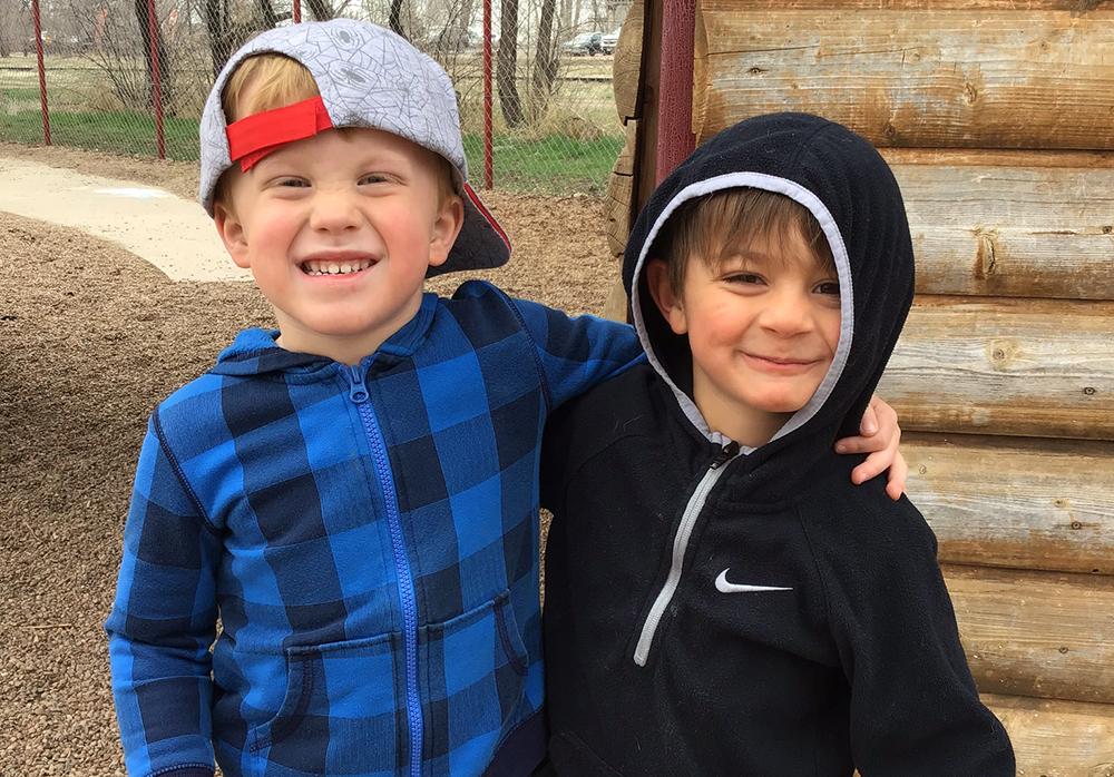 Two boys smiling at a preschool & childcare center Serving Erie, CO & Kansas City, KS