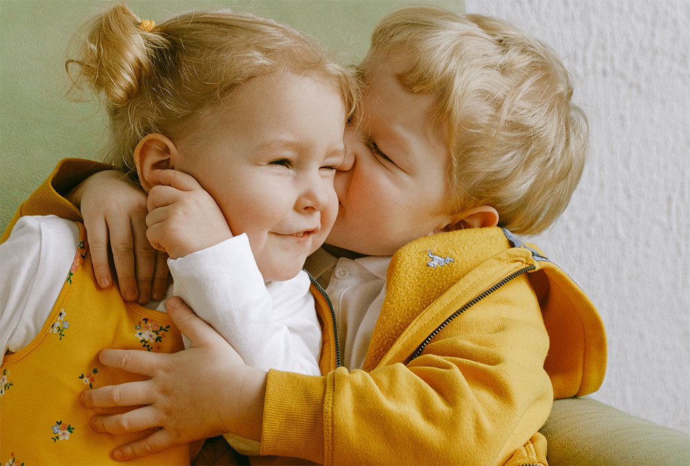 Two sweet little toddler playing at a preschool & childcare center Serving Erie, CO & Kansas City, KS