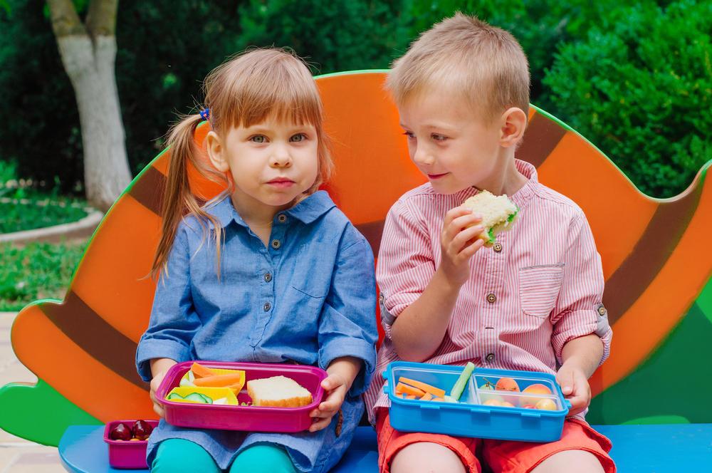 Kids sharing meal at a preschool & childcare center Serving Erie, CO & Kansas City, KS