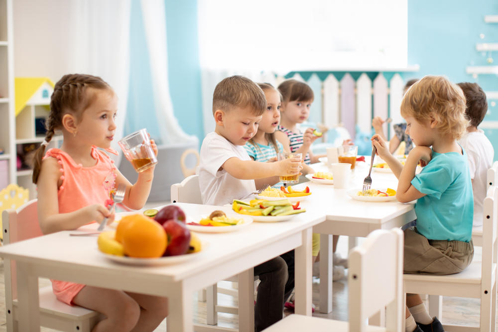 Cute little kids eating at preschool & childcare center Serving Erie, CO & Kansas City, KS