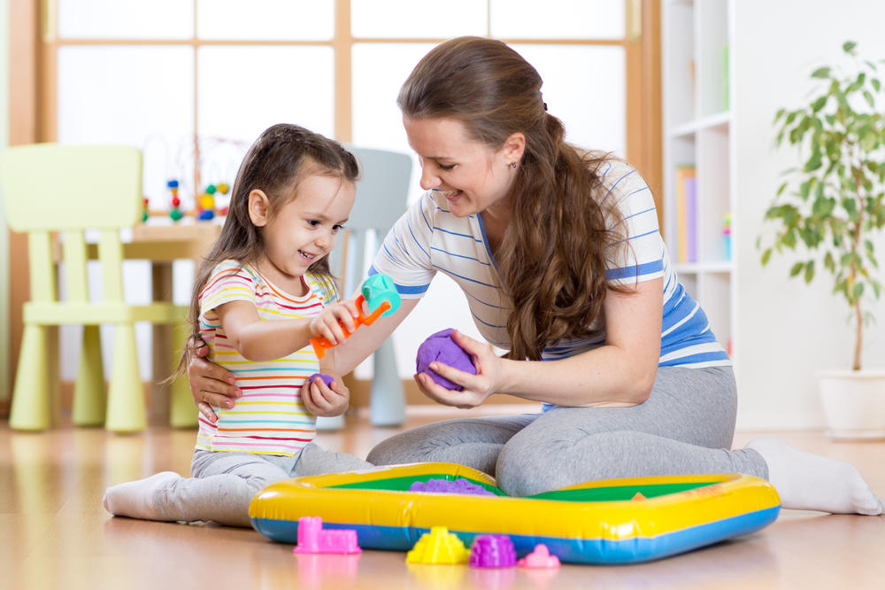 Mother and cute little girl playing at preschool & childcare center Serving Erie, CO & Kansas City, KS