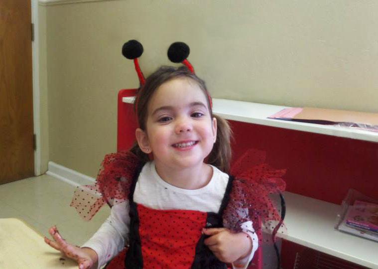 Cute little girl wearing a costume at a preschool & childcare center Serving Erie, CO & Kansas City, KS