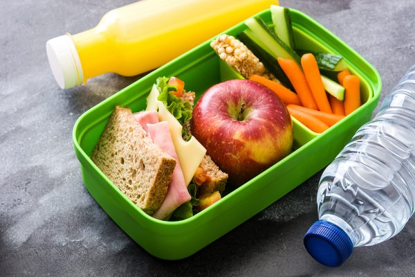 Healthy school lunch box: Sandwich, vegetables ,fruit and juice
